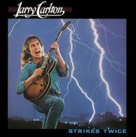 Strikes twice Larry Carlton, chant, guit. Paulinho da Costa, perc. John Ferraro, batt. Don Freeman, claviers